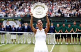Wimbledon champion Muguruza eyes more trophies not rankings
