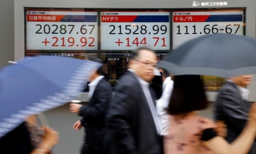 Asia stocks buoyant, dollar steadies after solid U.S. job gains