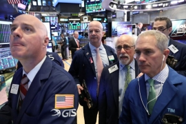 Wall Street gains as trade talks advance; Trump to declare emergency