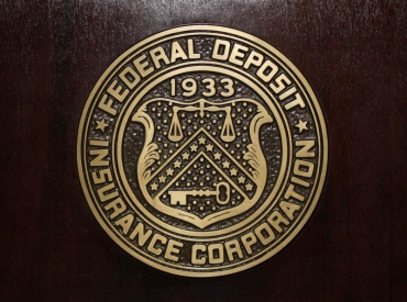 "FDIC nominee says will address ""hold-up"" in non-bank licenses"