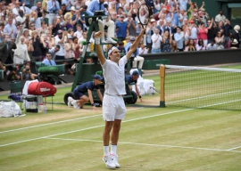 Federer wins record eighth Wimbledon title as Cilic crumbles