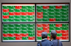 Asian shares jolted by weak Chinese data, growth risks
