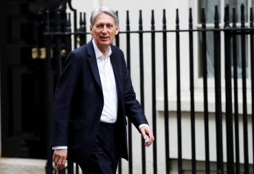 UK's Hammond sees light at end of austerity tunnel, but debt must fall