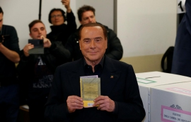 Berlusconi calls on defeated center-left to help form Italian government