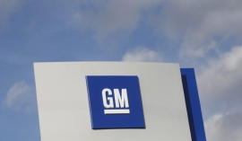 GM swings to third-quarter loss on charges from European unit sale